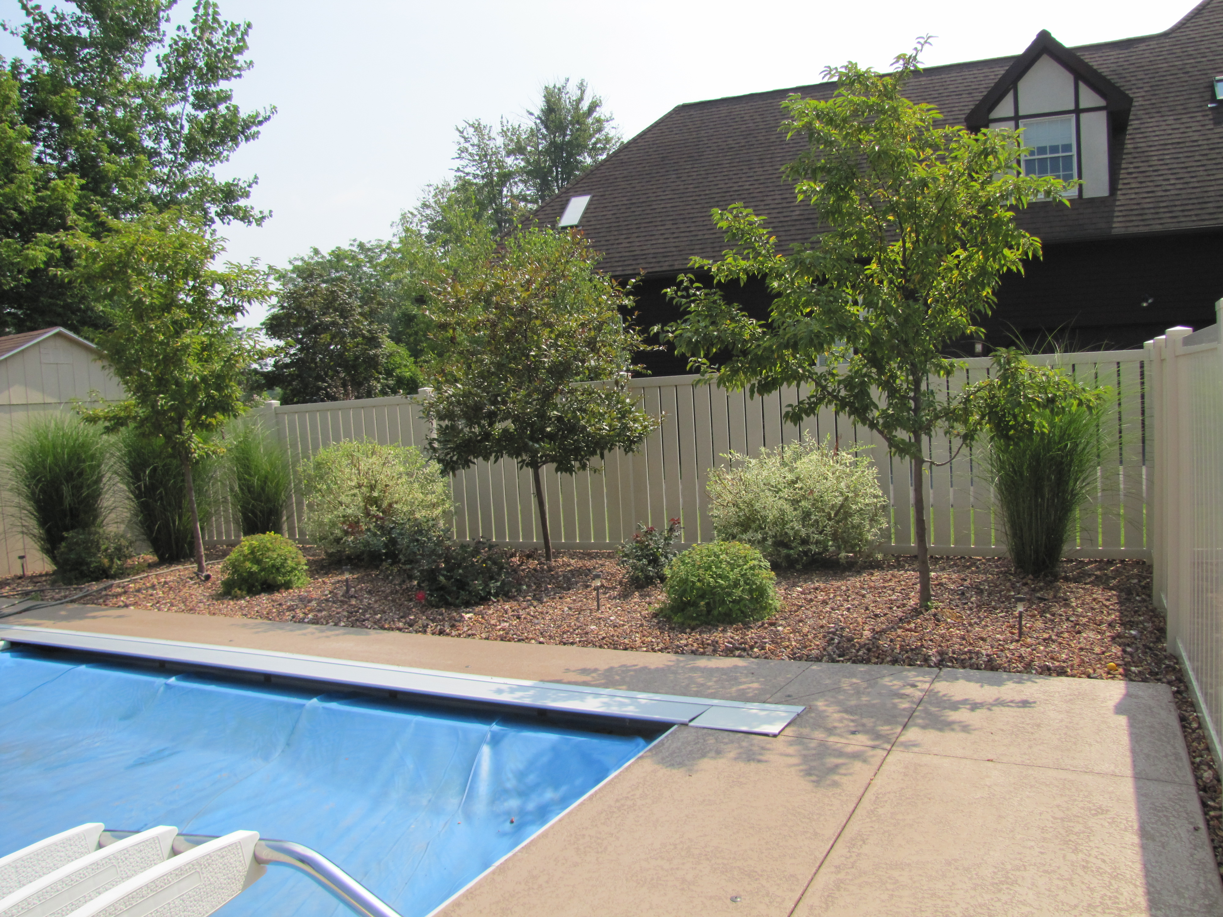 Landscape photo gallerygreenscapes garden center for Ideas for landscaping pool area